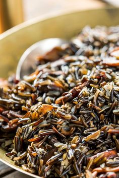 NYT Cooking: In Wisconsin, wild rice is truly wild, not cultivated as in other states, the tassels rising and swaying over rivers, lakes and floodplains come late… Paella, Wild Rice Recipes, Cooking Wild Rice, Vegetarian Recipes, Cooking Recipes, What's Cooking, Stuffed Mushrooms, Stuffed Peppers, Menu Planners