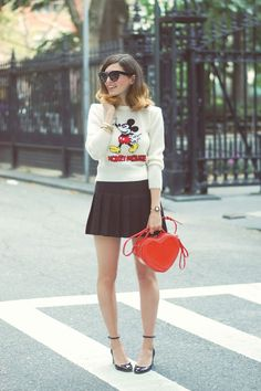 Emilee Anne wearing Vintage Disney Mickey Mouse Sweater // American Apparel Pleated Mini Skirt // Valentino Tango Mary Janes // Marc by Marc Jacobs Heart Bag // Celine Sunglasses