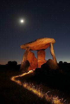 Stone henge with full moon.