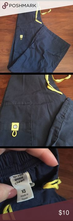 Wink scrub bottoms Navy blue Wink scrub bottoms. Bottoms are a flare. Fit great and are flattering. Lost matching top :/ size xs with elastic waist and drawstring. Great condition Pants