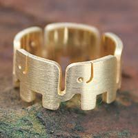 Gold plated band ring, 'Elephant Pride'      Symbolizing Thai pride, elephants shape this original ring. Jantana crafts the band by hand with 24k gold plated sterling silver featuring a matte finish. .925 Sterling silver   An artisan story card will be included with your purchase.