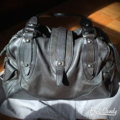 Black Soft Leather(ie Not too heavy) Perlina Purse Gently loved condition.  Only signs of aging/use are the parts of the handles that face inward (meaning you can't tell by looking at the purse while someone is wearing it). Zippered top.  All flaps close and stay with enclosed magnets.  I tried to showcase these details within the photos.  3 inner pockets, one is zippered.  Two outer pockets - 1 on each side of purse (great for keys, gum, metrocard, etc) Perlina Bags