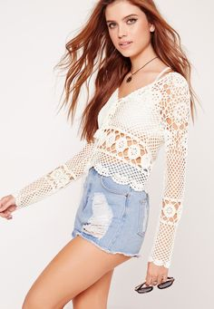 Here at MG, we've fallen head over heels for chic crochet. Featuring a classic cream hue, crop style, long sleeves and a crochet body, this is a statement piece to be rocking this season. Team up with ripped shorts and western boots or glad...