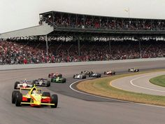 Tony Stewart leads the field during the restart of the 1997 Indy 500. The race was resumed on lap 16 after two days of rain allowed only 15 laps to be completed on Memorial Day. Arie Luyendyk is running second.