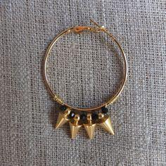 Créoles pointes de flèche or et ses cristaux noirs