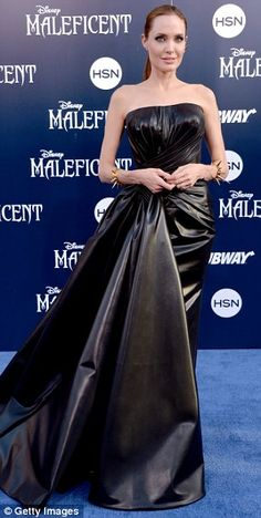 Black magic: Angelina looked incredible in her black leather strapless gown, which had ruc...