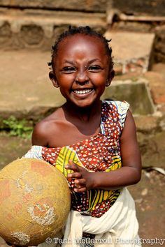 Smiles are free & can light up your life! A sweet little friend of mine, Rwanda