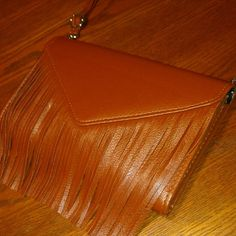 "✌Fringe Envelope Crossbody!✌ Perfect for the upcoming festival season! Faux leather envelope crossbody with extra fringe and a detachable strap to make it a clutch! Awesomely cute either way!   Strap: 12 1/2"" (at shortest length)             25"" (at longest length) Width: 9"" Height: 6"" Depth: 6 1/2"" (little bit of wiggle room at the top when closed)  *same or next day shipping!* *this item comes with a free gift!* Boutique  Bags Crossbody Bags"