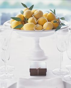 White compotes hold a bounty of sparkling sugared lemons accented with verdant eucalyptus.