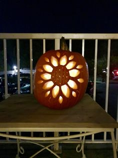 Sunflower Pumpkin Carving Design with LED light. Created this beautiful design with just the basic tools that come in a carving kit purchased from Target. Easy and beautiful.