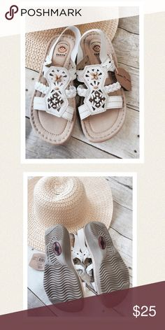 White sandals. Beaded and stitched. Float on air while wearing these adorable and very comfy white summer sandals. Leather uppers. Padded footbed for comfort and ridged rubber soles. Quality stitching with tan snd brown accent beads and elastic heel straps. New with tags. Never worn. Earth Spirit Shoes Sandals