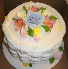 Buttercream iced cake with gumpaste flowers