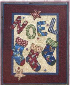 Quick and easy applique wall hanging for Christmas. Noel Quilt Pattern FRD-1111 by Fairfield Road Designs - Christine Baker.  Check out more of our quilt patterns. https://www.pinterest.com/quiltwomancom/quilts/  Subscribe to our mailing list for updates on new patterns and sales! http://visitor.constantcontact.com/manage/optin?v=001nInsvTYVCuDEFMt6NnF5AZm5OdNtzij2ua4k-qgFIzX6B22GyGeBWSrTG2Of_W0RDlB-QaVpNqTrhbz9y39jbLrD2dlEPkoHf_P3E6E5nBNVQNAEUs-xVA%3D%3D