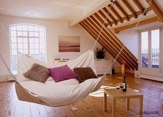 Oh so much perfection! White walls, wooden  floors, windows, and a hammock!