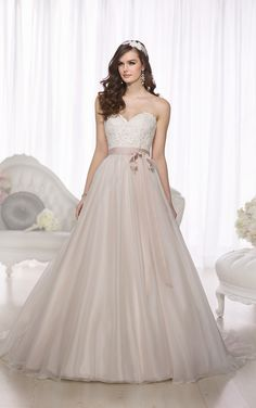 D1702 -  Constructed to give you an exceptional fit, this Soft Organza and Tulle designer ball gown wedding dress features a fitted bodice with elegant Lace details, a whimsical waist sash, and a flowing, full skirt. The lovely sweetheart neckline is designed to frame the face, while the light-as-air skirt breathes with glamour at every turn. The back zips up under fabric buttons that line the back of the skirt and extend to the floor. You can customize this elegant ball gown weddin...