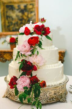 wedding cake with pink and red flowers - photo by Katherine OBrien Photography http://ruffledblog.com/dallas-wedding-with-couture-fashion