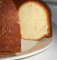"""Grandmother Paul's Sour Cream Pound Cake Recipe courtesy of Paula Deen and the Food Network. I like to make this one in NordicWare's """"violet"""" bundt pan. No frills, just good cake. Pound Cake Recipes, Easy Cake Recipes, Dessert Recipes, Pound Cakes, Dessert Bread, Meal Recipes, Easy Desserts, Free Recipes, Recipies"""