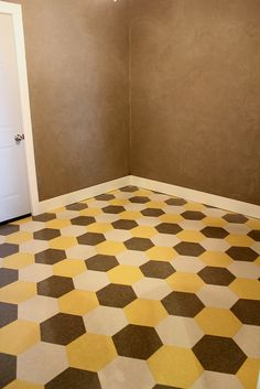 IMG_1940 by karapaslay, via Flickr. Hexagonal vinyl floor tile, cut from squares. Clever and frugal.