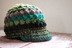 Ravelry: textured cap with brim - City Slicker pattern by Julie Cleary Crochet Hat With Brim, Crochet Beanie, Knit Or Crochet, Cute Crochet, Crochet For Kids, Crochet Crafts, Crochet Projects, Knitted Hats, Chunky Crochet