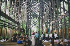 This unique woodland wedding venue chapel sits forty-eight feet tall in Arkansas. Containing over 400 windows and 6,000 sq. ft. of glass, this gorgeous glass sanctuary is perfect for woodland weddings. Photo: Cottonwood Studios