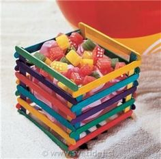 DIY box made from colored ice drop sticks joined together with melted glue sticks Lolly Stick Craft, Ice Cream Stick Craft, Popsicle Stick Art, Popsicle Stick Crafts, Craft Stick Projects, Craft Stick Crafts, Fun Crafts, Craft Sticks, Craft Ideas