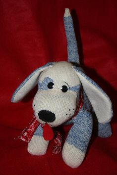Handmade Blue Sock Monkey Puppy Dog. Davinia had a very similar Sock Monkey Dog when she was little. It was the only stuffed animal she ever really played with. Hope she loves this one too.