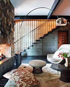 Love everything....stairs, fireplace, floor, pillow fabric, chair, light....