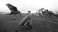 A Spanish police officer guards the wreckage of two Boeing 747 airliners that collided and burned on the runway of Tenerife Los Rodeos Airport in the Canary Islands on March 27, 1977, killing 583 people - the worst aviation disaster in history