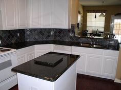 Image result for kitchens with uba tuba granite pictures