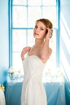 """Wedding dress """"Aphrodite"""" in silk with asymmetric chiffon and pearl details by Esther Catherine. ES Photography and Social Media. Styling by Miss Helen Williams, HVR Beauty, hair by Abigail Tooth. Shot in Kinross House, Scotland."""