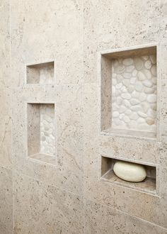From kitchendetailsanddesign.com. Use as many natural stone tiles as you can afford! Love the pebbles at the back of the niches.