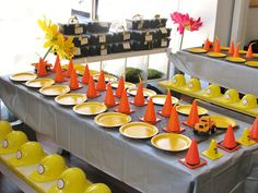 Cone hats- Construction party table setting The gray table cloth is cute too! Less halloweeny than orange