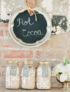 give hot chocolate and marshmallows in mason jars for fall wedding favors!   The Knot Blog