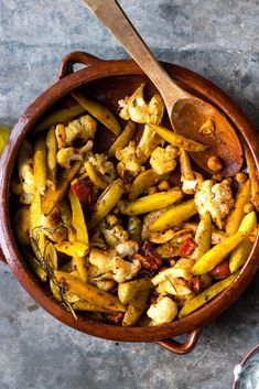 Spiced Chickpeas With Cauliflower and Roasted Lemon Recipe - NYT Cooking Vegetarian Recipes, Cooking Recipes, Cooking Bacon, Cooking Games, Cooking Turkey, Roast Fish, Cooking Courses, Roasted Cauliflower, Cauliflower Potatoes
