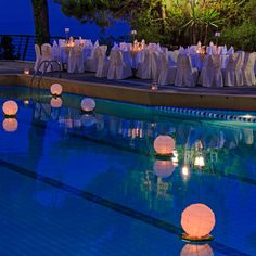 Stock image of 'Floating water lantern in the pool'