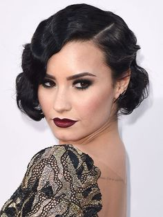 Demi Lovato proved that fingers waves don't just belong at 1920s costume parties. To get her look, curl your whole head with a three-quarter-inch curling iron with the front pieces going toward your face, then roll up the curls toward your scalp and pin them in place to cool. After you've swiped through your batch for the day on Hinge, let the curls down and gently brush through with a boar bristle brush, like Mason Pearson.
