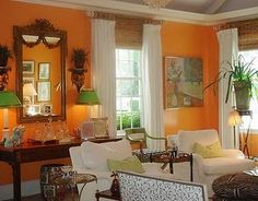 Love this orange room with touches of green by Celerie Kemble. (with a name like Celerie, what else would you use?! I do like the freshness of this scheme. It's colonial in feel.)