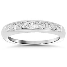 This elegant womens diamond wedding band features brilliant round cut diamonds set half way across the band. The band measures to 3.5 mm in width and weighs 4.1 grams. This band is an ideal gift for that special day. $1,601.00