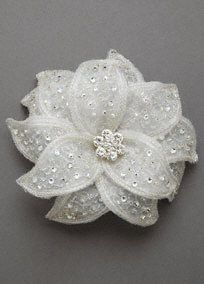A beautiful classic flower for a beautiful bride!  Floral clip features sparkling crystal cluster center.  Stunning fabric leaves with silver embroidery, beadwork and crystals finish off the look.  Available in Ivory. Imported.