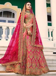 Shop Online Embroidered Satin Bridal Lehenga in Fuchsia. Shimmer and sparkle this season in this showstopper lehenga decorated with resham, zari, stone and patch border work. This lehenga comes with a semi-stitched satin choli in fuchsia and two net dupat Indian Bridal Outfits, Indian Bridal Lehenga, Indian Bridal Fashion, Indian Dresses, Bridal Dresses, Eid Dresses, Dresses Online, Formal Dresses, Choli Designs