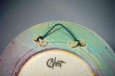 Great idea for hanging pottery. Artist's Images: John Calver