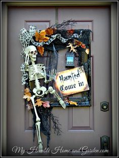 """DIY:  How to Make this Awesome Halloween """"Wreath"""" - using a picture frame + a skeleton and other craft store supplies - via My Humble Home and Garden #halloweencrafts #howtousepictureframeshowtomake"""