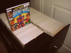 An example of using a filing cabinet to store comics books - comic book storage solutions. Check classifieds and used office furniture stores and you might find one at a good price.
