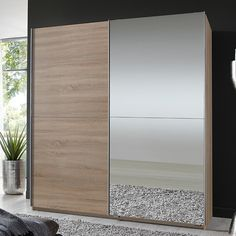 Quest Oak Robe 2 Door Sliding Wardrobe With 1 Mirrored Door Quest Robe Sliding Wardrobe With Oak Frame One Mirror One White Door The #Wardrobe is finished in an white finish with one stylish #mirrored doors and one Oak door ,with hanging space and two shelves, German made,
