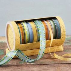 Ribbon storage. repurposed oatmeal canister. could create wooden skewer insert to stablize the rolls.