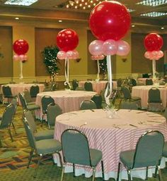Jumbo balloons mimicking gum balls, like gum balls on cup cakes and on the candy table. WIth blue and white? I loved it