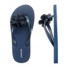 Topped with a sweet little flower, they're the pair she'll pick every time. <ul><li>Rubber upper.</li><li>PVC footbed and sole.</li><li>Import.</li></ul>