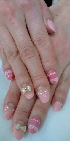 Pink ribboms and lace nails.