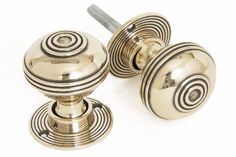 From the Anvil Prestbury Door Knob- A solid pair of handcrafted door knobs, popular for their weight and simplicity. The finishes achieve a Contemporary take on a Traditional Handle, simple but a real classic. These knobs will tarnish in time as part of the ageing process but can be polished time and time again if you want to achieve a more contemporary finish.
