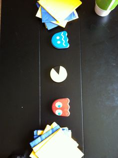 simple coffee table decor- kid friendly so they didnt destroy or eat any decor... pacman candy tins and napkins